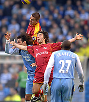 Photo: Paul Greenwood.<br />Man City v Reading. The Barclays Premiership. 03/02/2007. Reading's Stepehen Hunt, foreground, claims a foul