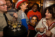 A group of Democratic party supporters look ecstatically happy after the final news of their Man's victory. Gone is the nervous tension earlier in the evening when these party faithful arrived for a whole night following developments. Polls suggested Obama was doing well against his Republican adversary, John McCain in this historic political election which saw the election of America's first black Commander in chief. The location is a pub called the Hoop and Toy, in South Kensington, West London which has been opened all night for this special event for the American expatriate community living in this European capital.