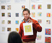Visual design assistant professor Doug Goldsmith shows students some work during his class in the Art Building.