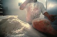 Salting Parma Ham, Langhirano, Italy - Photograph by Owen Franken