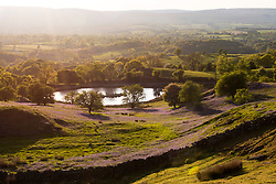 © Licensed to London News Pictures. 13/05/2020. Howey, Powys, Wales, UK. The sun goes down over a moor land landscape on an unseasonably cold but fine evening near Howey in Powys, Wales, UK. Photo credit: Graham M. Lawrence/LNP