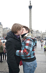 "© licensed to London News Pictures. London, UK 12/02/2012. Gay rights campaigners kissing at Trafalgar Square before posting a Valentine's Day card to Buckingham Palace calling on the Queen to help ""kiss goodbye to homophobia"" in some Commonwealth countries. Photo credit: Tolga Akmen/LNP"