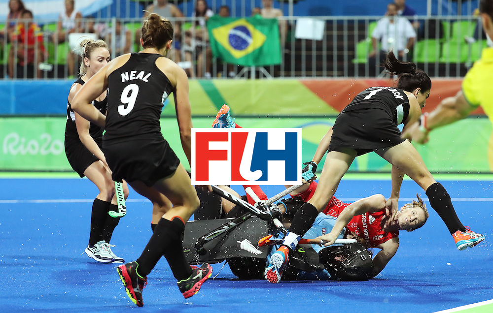 RIO DE JANEIRO, BRAZIL - AUGUST 17: Helen Richardson-Walsh #8 of Great Britain crashes into Sally Rutherford #8 of New Zealand during the Women's Semifinal match on Day 12 of the Rio 2016 Olympic Games at the Olympic Hockey Centre on August 17, 2016 in Rio de Janeiro, Brazil.  (Photo by Rob Carr/Getty Images)