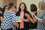 Keri Fovargue reacts during a Children at Risk awards presentation to area schools at Pilgrim Academy, June 6, 2016.