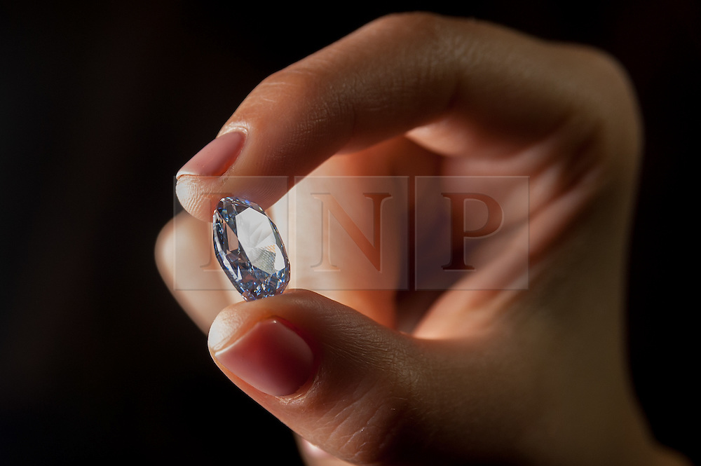 © Licensed to London News Pictures. 15/03/2016. London, UK.  The 'De Beers Millennium Jewel 4', a rare and superb oval internally flawless fancy vivid blue diamond weighing 10.10 carats is displayed at Sotheby's in New Bond Street ahead of its auction in Hong Kong on 5 April.  It is the largest oval fancy vivid blue diamond ever to appear at auction (Est. HK$235 – 280 million / US$30 – 35 million) and is the only oval-shaped stone among the twelve rare diamonds - eleven blue and one colourless – that form the world-renowned De Beers Millennium Jewels collection, unveiled by De Beers in 2000 in celebration of the millennium.  Each of the eleven blue diamonds in the collection boasts a combination of colour intensity, even saturation and brilliance that are rivalled by few other stones. Photo credit : Stephen Chung/LNP