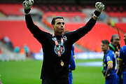 AFC Wimbledon goalkeeper Kelle Roos (29) celebrates promotion in front of the AFC Wimbledon fans after the Sky Bet League 2 play off final match between AFC Wimbledon and Plymouth Argyle at Wembley Stadium, London, England on 30 May 2016. Photo by Graham Hunt.