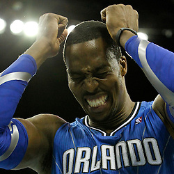 January 27, 2012; New Orleans, LA, USA; Orlando Magic center Dwight Howard (12) reacts to a missed basket against the New Orleans Hornets during the second half of a game at the New Orleans Arena. The Hornets defeated the Magic 93-67.  Mandatory Credit: Derick E. Hingle-USA TODAY SPORTS