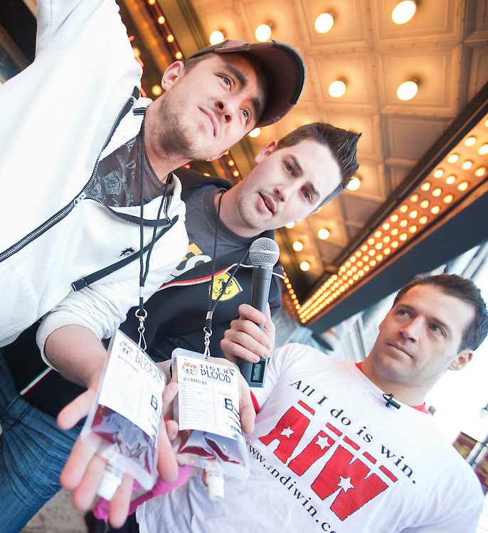 Charlie Sheen fans show off their &quot;Tiger Blood&quot; energy potion in front of the Fox Theatre in Detroit, Michigan April 2, 2011 where Sheen starts the cross country tour of his show &quot;Violent Torpedo of Truth/Defeat is Not an Option&quot;.<br /> AFP/GEOFF ROBINS/STR