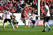 Walsall midfielder Romaine Sawyers skips away from Crewe Alexandra defender Ben Nugent during the Sky Bet League 1 match between Walsall and Crewe Alexandra at the Banks's Stadium, Walsall, England on 26 September 2015. Photo by Alan Franklin.