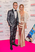 Ollie Proudlock (Made in Chelsea) and his girlfriend Emma Connolly - UK charity, Sport for Freedom (SFF), marks Anti-Slavery Day 2015 by hosting a charity Gala Dinner, supported by Aston Martin, on Thursday 15th October at Stamford Bridge, home of Chelsea Football Club. This inaugural event brought together people from the world of sport, entertainment, media, and business to unite behind a promise to tackle the issue of modern day human trafficking and slavery.  <br /> Hosted by Sky presenters Sarah-Jane Mee and Jim White, the Sport for Freedom Gala Dinner includes guests such as jockey AP McCoy OBE; Denise Lewis, former British Olympic Gold Medal winner; BBC Strictly star, Brendan Cole; Al Bangura, former Watford FC player and Sport for Freedom Ambassador who was trafficked from Africa to the UK at the age of just 14yrs old; Made in Chelsea star, Ollie Proudlock; ITV weather presenter, Lucy Verasamy; Sky Sports F1 presenter and SFF Ambassador, Natalie Pinkham; Premier League footballers Ryan Bertrand of Southampton FC and Troy Deeney of Watford FC and champion boxer, Anthony Joshua; and The UK's first independent Anti Slavery Commissioner, Kevin Hyland OBE, who highlighted the issues of modern day slavery that face the UK and world today. <br /> The evening concluded with chart topping music from 'Naughty Boy'. <br /> Sport for Freedom are also joining forces with the Premier League Academies for an international  'Football for Freedom' tournament with their U16's players that will also involve educating those taking part about the issues surrounding modern day slavery. The final will take place at Liverpool FC's Academy on Anti-Slavery Day, 18th October.