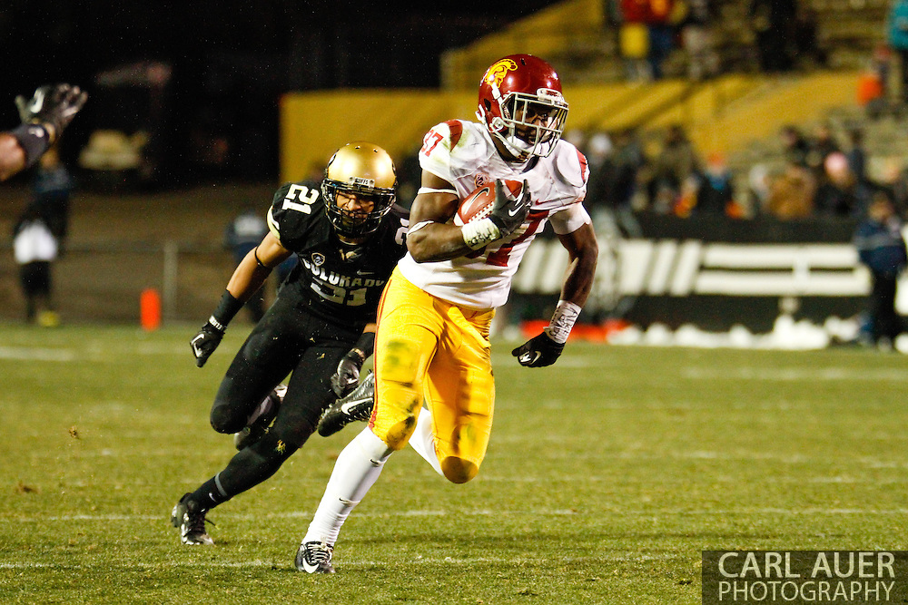November 23rd, 2013: USC Trojans sophomore running back Javorius Allen (37) outruns Colorado Buffaloes junior defensive back Jered Bell (21) on the way to the end zone in the third quarter of the NCAA Football game between the University of Southern California Trojans and the University of Colorado Buffaloes at Folsom Field in Boulder, Colorado