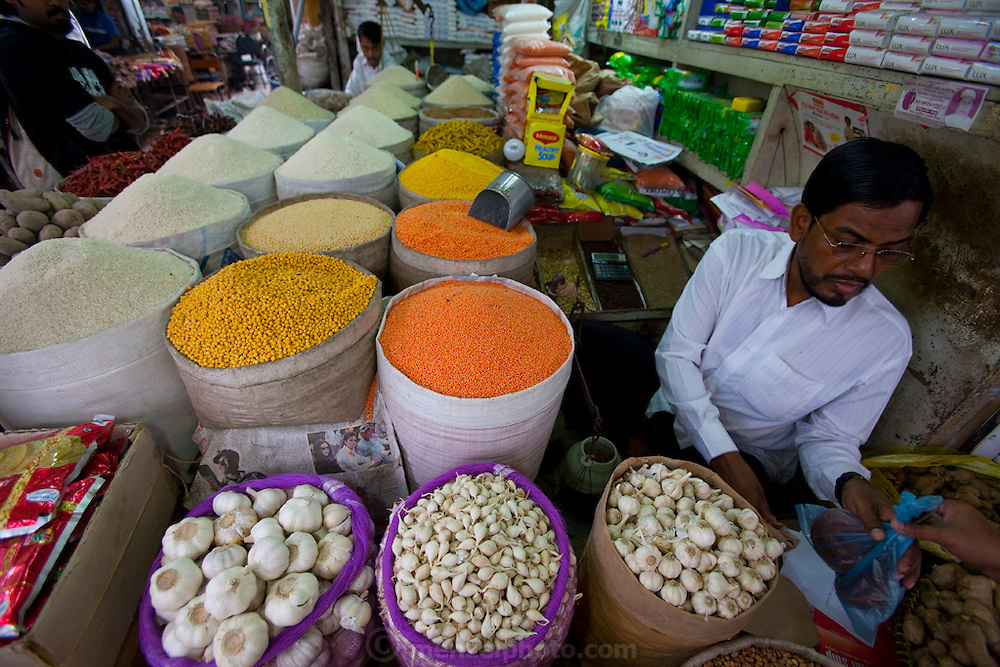 A vendor sells vegetables and other farm produce at the Santinagar  market in Dhaka, Bangladesh.