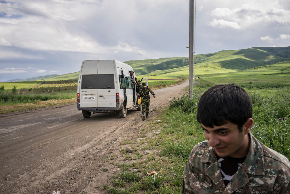 Fighters from the Nagorno-Karabakh military stop by the side of the road to switch vehicles on Sunday, May 8, 2016 in Martakert, Nagorno-Karabakh.