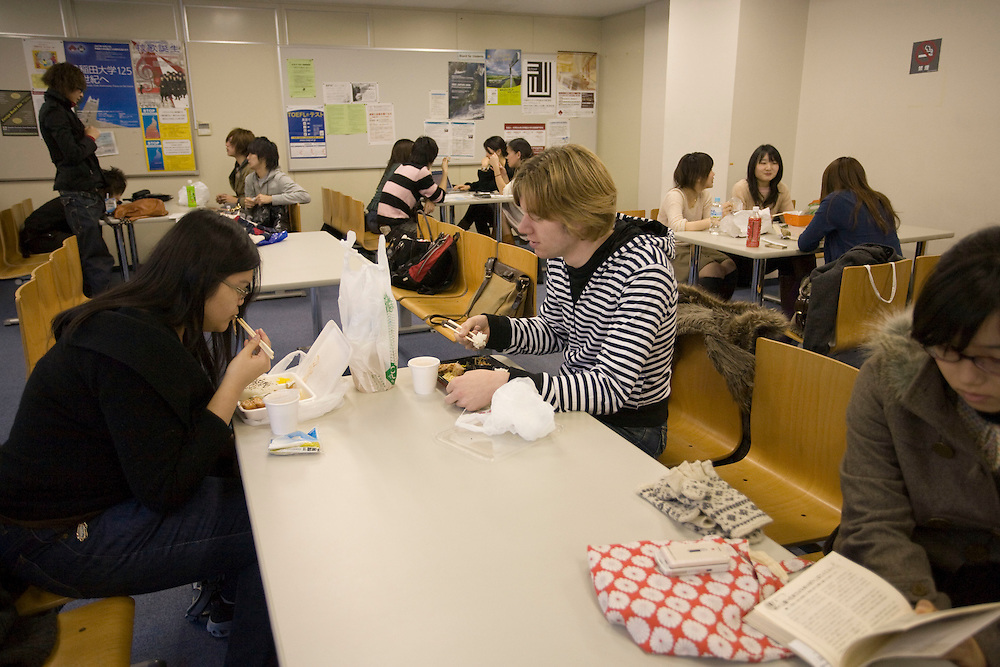 "Waseda  University Heinz Stuki 24 a Swiss Biology student and Marilyn  Manan, 22 from Brunei,  International Relations, enjoy a Typical Japanese  ""Bento"" Lunch Box in the  Student Lounge"