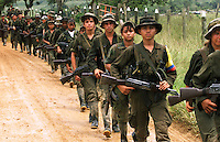 FARC rebels march in La Macarena, in the former FARC controlled zone of Colombia. The FARC are Colombia's oldest and largest rebel group numbering over 18,000 rebels, many of whom are young boys and girls. (Photo/Scott Dalton)