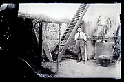 man posing in barn 1920s France