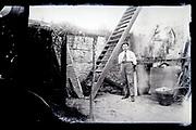 man posing in barn 1920s France