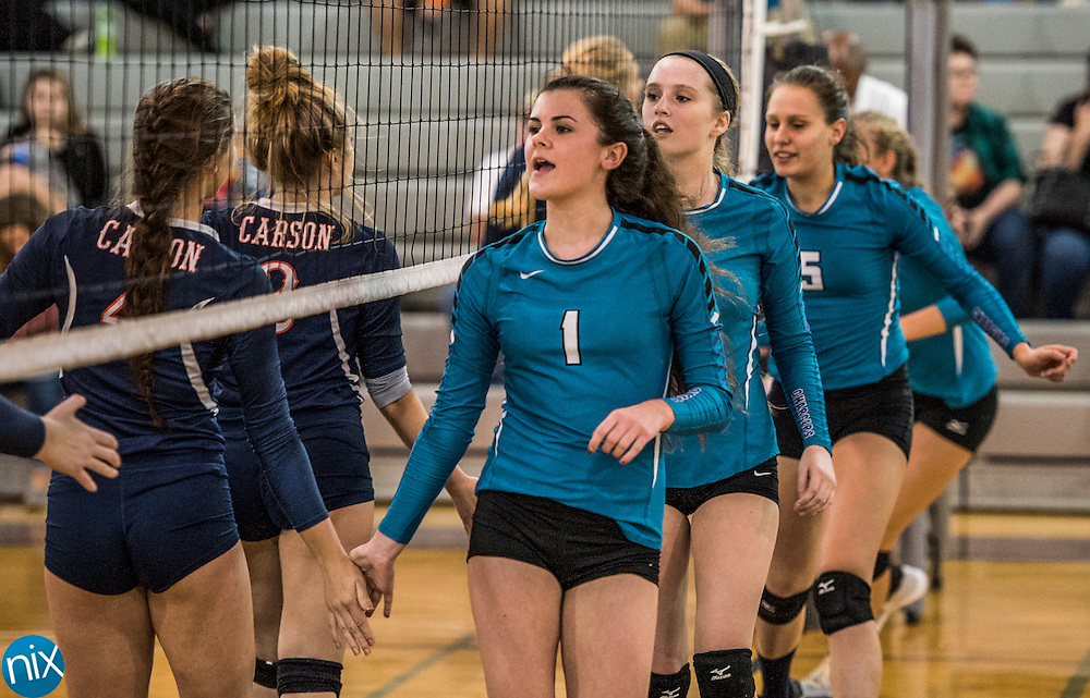 Cox Mill against Carson during the South Piedmont Conference volleyball championship game. at Cox Mill High School Wednesday night. Cox Mill won the championship 22-25, 25-17, 25-19, 25-12.