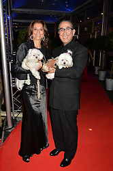 DAVID & MARION KHALILI with their dogs Lulu & Lola at Battersea Dogs & Cats Home's Collars & Coats Gala Ball held at Battersea Evolution, Battersea Park, London on30th October 2014.