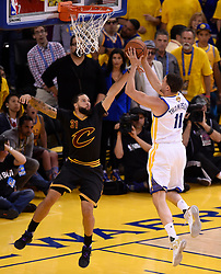 The Golden State Warriors' Klay Thompson, right, goes up for a basket against the Cleveland Cavaliers' Deron Williams during the second quarter of Game 5 of the NBA Finals at Oracle Arena in Oakland, Calif., on Monday, June 12, 2017. (Photo by Jose Carlos Fajardo/Bay Area News Group/TNS) *** Please Use Credit from Credit Field ***