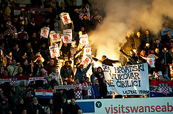 SWANSEA, WALES - Tuesday, March 26, 2013: Croatia supporters light a flare and hold up a banner 'Za Hrvatski Vukovar Ne Cirilci' during the 2014 FIFA World Cup Brazil Qualifying Group A match against Wales at the Liberty Stadium. (Pic by Tom Hevezi/Propaganda)