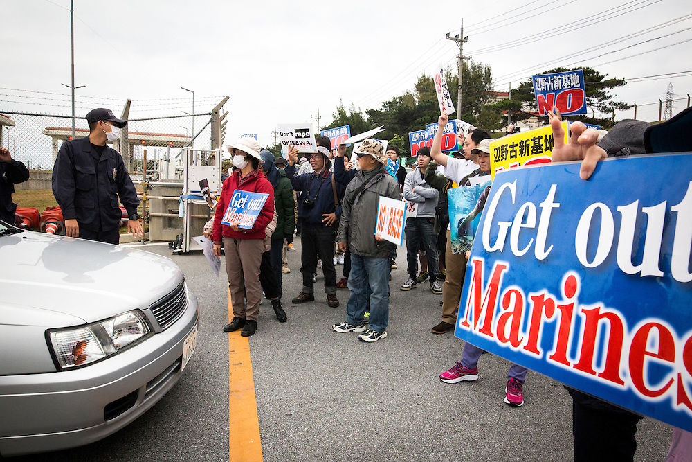 OKINAWA, JAPAN - FEBRUARY 1 : Anti U.S. Base protesters shout with placards and block the cars of US marines from getting out of the U.S Marine Camp Schwab gate, protesting against the construction of the new U.S Marine Airbase in Nago, Okinawa, Japan on Wednesday, February 1, 2017. Okinawa Gov. Takeshi Onaga arrived in the United States on Tuesday, aiming to convey to President Donald Trump's administration local opposition to a plan to relocate a U.S. airbase within the southern island prefecture. (Photo by Richard Atrero de Guzman/NURPhoto)
