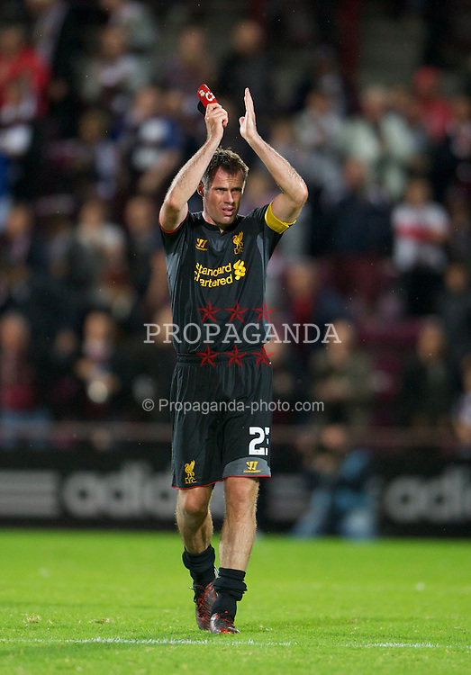 EDINBURGH, SCOTLAND - Thursday, August 23, 2012: Liverpool's Jamie Carragher applauds the travelling supporters after the 1-0 victory over Heart of Midlothian UEFA Europa League Play-Off Round 1st Leg match at Tynecastle. (Pic by David Rawcliffe/Propaganda)