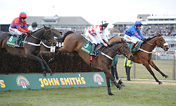 THE JOHN SMITHS MELLING CHASE..Winner SPRINTER SACRE( red - blue 6 ) jumps with FLEMENSTAR (  3  ) and CUE CARD during the race, Aintree Racecourse, Aintree, Merseyside, England. April 5, 2013. Photo by Racingfotos.com / i-Images...