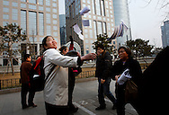 Chinese petitioners throw written accounts of their grievances in the air at a busy shopping street, near Tiananmen square, in hopes to have her case seen and heard by a larger audience, after failed attempts to have their cases heard at the Petition's office  in  Beijing, China, Tuesday, March 3, 2009.Widespread frustration with the petition system is simmering and in several recent cases has boiled over, with a handful of people making desperate bids for attention. The peak season for the pilgrimages is the beginning of March, when China's lawmakers gather in the capital for their once-a-year legislative session. In an acknowledgement that the petition system is in crisis, China's Premier Wen Jiabao vowed to improve legal channels for grievances.