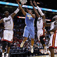 19 March 2011: Denver Nuggets shooting guard Arron Afflalo (6) goes for the layup between Miami Heat power forward Chris Bosh (1) and Miami Heat shooting guard Dwyane Wade (3) during the Miami Heat 103-98 victory over the Denver Nuggets at the AmericanAirlines Arena, Miami, Florida, USA.