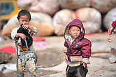 Children play In china's largest landfill