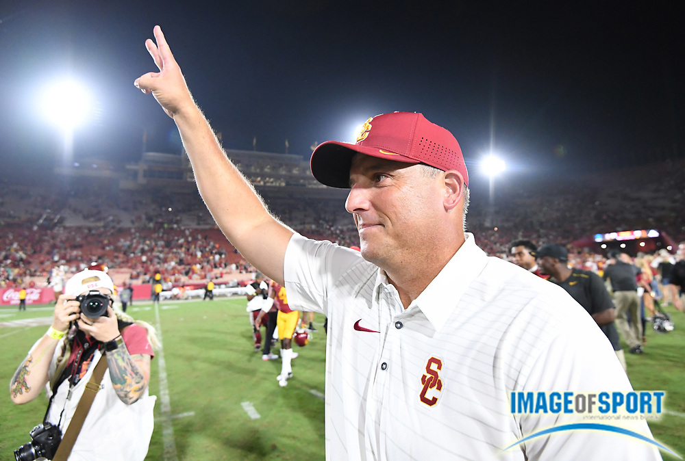 "Sep 9, 2017; Los Angeles, CA, USA; Southern California Trojans head coach Clay Helton displays the ""Fight On"" sign after a NCAA football game against the Stanford Cardinal at Los Angeles Memorial Coliseum. USC defeated Stanford 42-24."