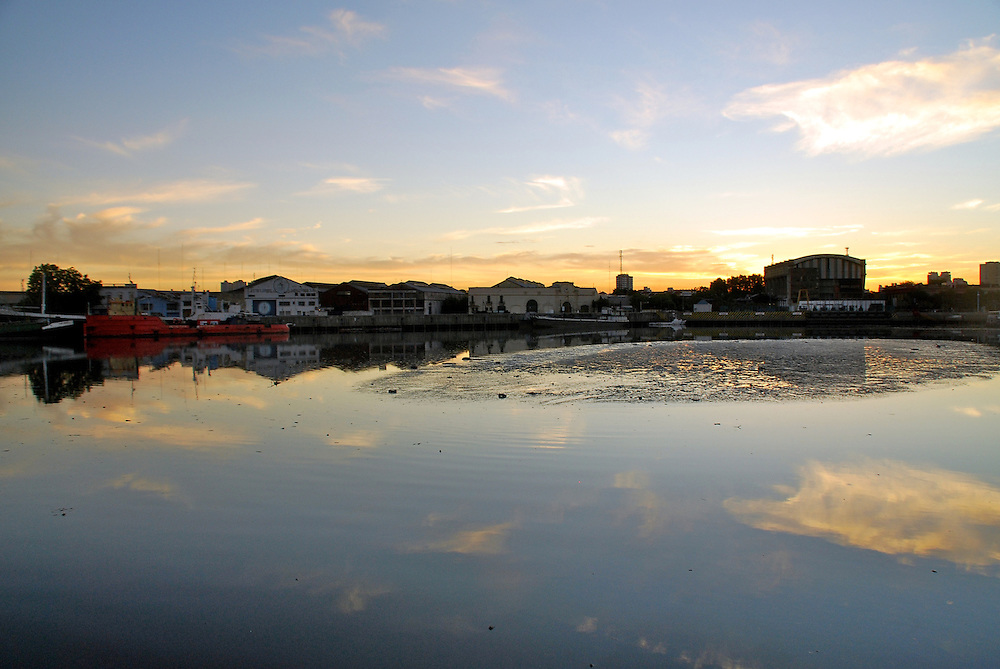 Sunset in the Riachuelo, in La Boca, Buenos Aires, Argentina, also view of shipyards docks.