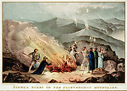 Signal fires on the Slievenamon Mountains - Ireland, 1848 / Lith. & pub. by N. Currier, 152 Nassau St. Cor. of Spruce N.Y.  Currier & Ives--Signal fires on the Slievenamon. Print shows a group of men surrounding a bonfire on a mountaintop during an insurrection in Tipperary. Three men hold weapons while other men tend the fire. lithograph, hand-colored.  c1848 Oct. 2