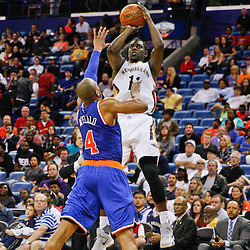 Mar 28, 2016; New Orleans, LA, USA; New Orleans Pelicans guard Jrue Holiday (11) shoots over New York Knicks guard Arron Afflalo (4) during the second half of a game at the Smoothie King Center. The Pelicans defeated the Knicks 99-91. Mandatory Credit: Derick E. Hingle-USA TODAY Sports