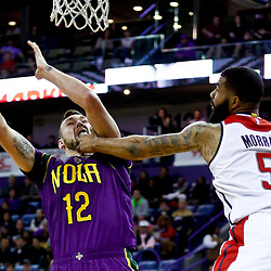 Jan 29, 2017; New Orleans, LA, USA; New Orleans Pelicans forward Donatas Motiejunas (12) is fouled by Washington Wizards forward Markieff Morris (5) during the second half of a game at the Smoothie King Center. The Wizards defeated the Pelicans 107-94. Mandatory Credit: Derick E. Hingle-USA TODAY Sports