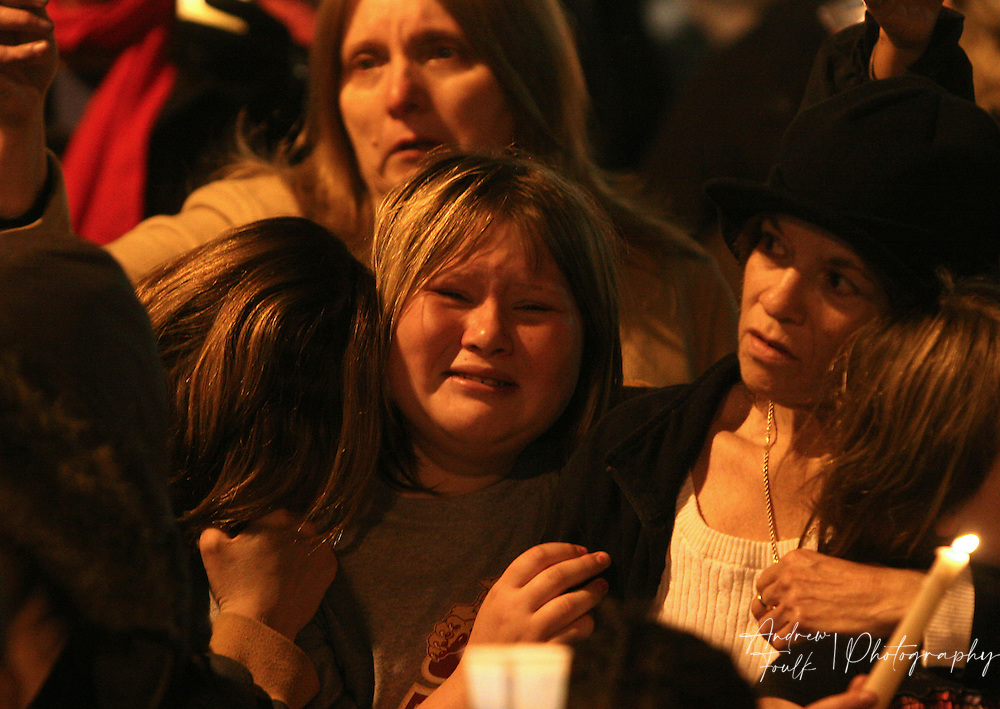 "/Andrew Foulk/ For the North County Times/  .A mourner breaks down into tears as around a thousand people sing ""Amazing Grace"" in remembrance of Amber Dubois during a Vigil in her honor at Escondido High School Monday night."