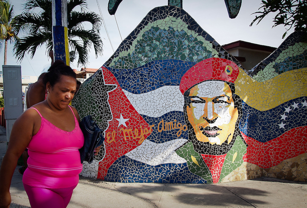 Ten miniutes drive from Old Havana Cuban Artist José Fuster has inspired his whole neighbourhood of Jaimanitas to decorated their homes and fences in mosaic tiles. Its a great introduction to the whimsical wonderland where he lives and creates his work at Fusterlandia. He has out he has out-Gaudied Gaudi. Travel images from Havana Cuba. Pictures by Chris Pavlich Photography.