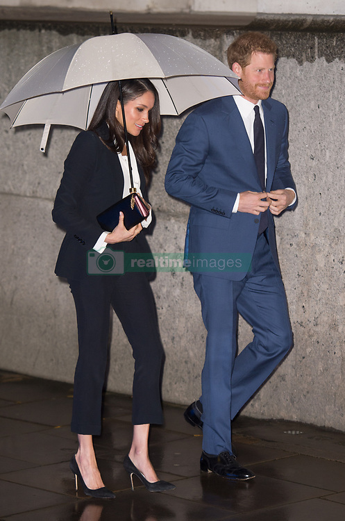 Prince Harry and Meghan Markle, attending their first official engagement together, arrive at the Endeavour Fund Awards at Goldsmiths' Hall in London on February 01, 2018.  Ms. Markle wore a dark Alexander McQueen trouser suit and white shirt for the occasion.