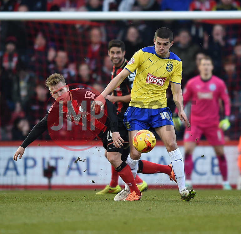 Bournemouth's Matt Ritchie tussles with Huddersfield Town's Conor Coady - Photo mandatory by-line: Paul Knight/JMP - Mobile: 07966 386802 - 14/02/2015 - SPORT - Football - Bournemouth - Goldsands Stadium - AFC Bournemouth v Huddersfield Town - Sky Bet Championship