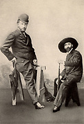 Max Kalbeck, biographer of Johannes Brahms, left, and Brahms' Viennese friend Dr Otto Bauer, wearing each other's hats.  From photograph taken in Ischl, 1892.
