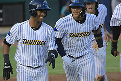 May 19, 2017 - Trenton, New Jersey, U.S - GLEYBER TORRES (center), an infielder for the Trenton Thunder, and his teammates who also scored in the third inning on Torres's grand slam, return to the dugout following his homer versus the Portland Sea Dogs at ARM & HAMMER Park. (Credit Image: © Staton Rabin via ZUMA Wire)