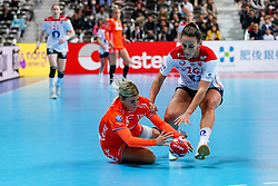 06-12-2019 JAP: Norway - Netherlands, Kumamoto<br /> Last match groep A at 24th IHF Women's Handball World Championship. / The Dutch handball players won in an exciting game of fear gegner Norway and wrote in the last group match at the World Handball  World Championship history (30-28). / Angela Malestein #26 of Netherlands, Marta Tomac #26 of Norway