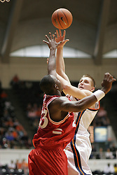 Laurynas Mikalauskas (11) shoots over a Hartford defender.  Mikalauskas scored 8 points to help UVA beat the Hawks 71-62...The Virginia Cavaliers defeated Hartford 71-62 at University Hall in Charlottesville, VA on December 31, 2005.