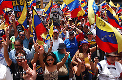 Opposition to President Hugo Chavez march in celebration two days after the Venezuelan National Electoral Council announced projections that the opposition had indeed collected enough signatures to convoke a referendum. There are still many obstacles that the opposition must overcome, ranging from the date of the referendum to deciding who would challenge the President.