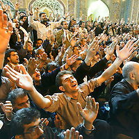 Shiite men pray inside of the Imam Ali Shrine in the Iraqi city of Najaf. The Shiites, long oppressed under the former regime, make up more than 60 percent of the Iraqi population. November 2003.