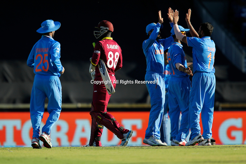 06.03.2015. Perth, Australia. ICC Cricket World Cup. India versus West Indies. Indian players celebrate the wicket of Darren Sammy.