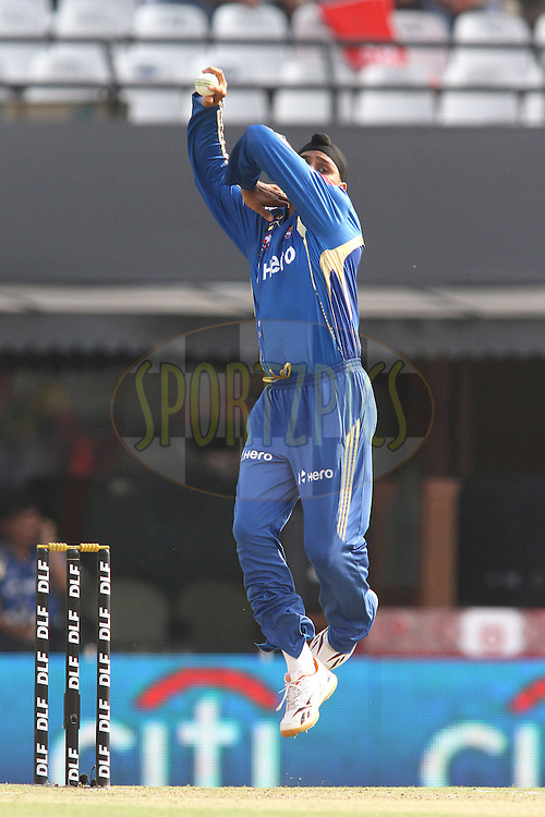 Mumbai Indians captain Harbhajan Singh sends down a delivery during match 33 of the the Indian Premier League (IPL) 2012  between The Kings X1 Punjab and The Mumbai Indians held at the Punjab Cricket Association Stadium, Mohali on the 25th April 2012..Photo by Shaun Roy/IPL/SPORTZPICS