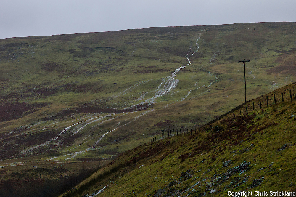 Selkirk, Scottish Borders, UK. 30th December 2015. Water cascades off the Border hills near Selkirk as Storm Frank moves across the South of Scotland.