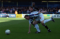 Photo: Olly Greenwood.<br />Colchester United v Brentford. Coca Cola League 1. 01/04/2006. Colchesters Kevin Watson and Brentfords Paul Brooker